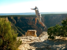 Arno taking a leap on to a small rock ledge on the Southern Rim of the Grand Canyon
