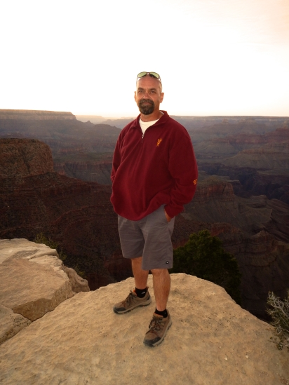 Me standing on a ledge of the Southern Rim of the Grand Canyon