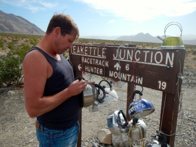 Arno, signing a kettle at Teakettle Junction, Death Valley National Park, CA