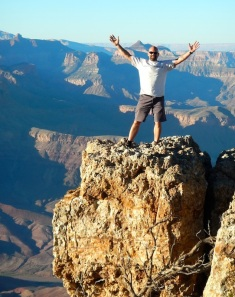 Me standing on a ledge on the Southern Rim of the Grand Canyon