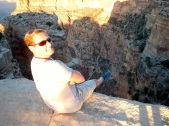 Arno, sitting on a ledge on the Southern Rim of the Grand Canyon